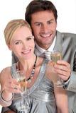 Par med champagne Fotografering för Bildbyråer