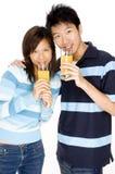 Par med fruktsaft Arkivfoto