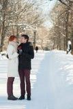 Par med klubbor parkerar in Fotografering för Bildbyråer