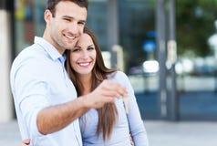 Par med tangenter för nytt hus Arkivbild