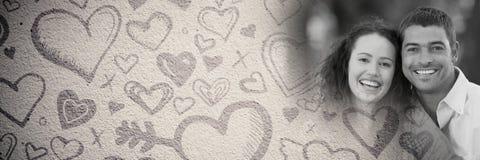Par med valentin hjärtor för förälskelseövergång Arkivfoton