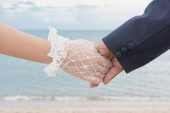 Par på en strand i Asien. Arkivbild
