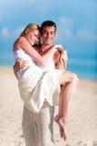 Par på strand Arkivfoto