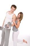 par som övar sunda vikter för kondition Arkivbild