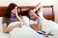 Par som har förkylning Royaltyfria Bilder