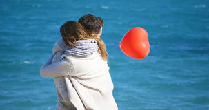 par som kramar barn Fotografering för Bildbyråer