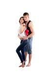 Par som kramar med en röd hjärta Arkivbilder