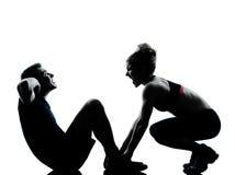 par som övar genomkörare för kvinna för konditionman en Royaltyfri Bild