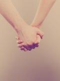 Par som rymmer deras händer Royaltyfri Foto