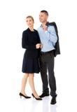Par som talar om deras korporation fotografering för bildbyråer