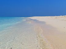 Paraíso blanco de la arena Fotos de archivo libres de regalías