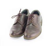 Para bruna läderskor som isoleras på vit bakgrund, klassiker Fotografering för Bildbyråer
