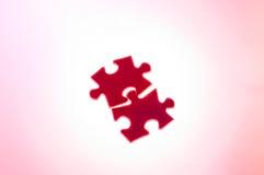 Para ensamblar el rompecabezas (color de rosa) Imagen de archivo libre de regalías