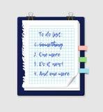 Para fazer a lista em um papel do bloco de notas Fotos de Stock