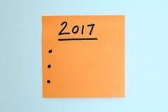 Para fazer a lista pelo ano novo na laranja Imagem de Stock