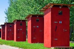 Para fora banheiros da porta Imagem de Stock Royalty Free