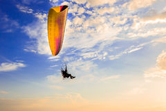 Paraglider flying in the blue sunny sky with clouds, Paragliding. Para-glider flying in the blue sunny sky with clouds, Paragliding Stock Images