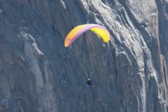Para-glider in front of mountain. A para-glider flies  in front of a high mountain Royalty Free Stock Photo