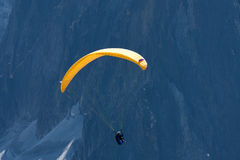 Para-glider in front of mountain. A para-glider flies  in front of a high mountain Royalty Free Stock Photography