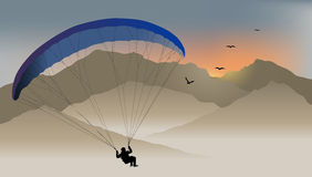 Para-glider hovers over the mountain Stock Images