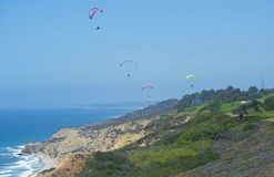 Para-gliders, Torrey Pines Golf Course, California. Four para gliders sail over the green grass of the fairways of the legendary  Torrey Pines Golf Course, home Stock Images