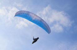 Para gliding. A paraglider against a clear blue sky royalty free stock photo