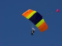 Para gliding. Parachutist riding the wind stock photo