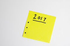 Para hacer la lista por el Año Nuevo en amarillo Imagen de archivo libre de regalías