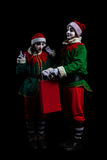 Para nowego roku elfa mimowie odizolowywający fotografia stock