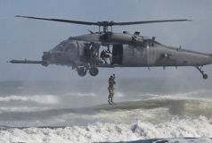 Para rescue. A US Air Force para rescue group out of Florida shows a practice rescue during an air show off the coast of Florida Royalty Free Stock Images
