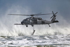 Para rescue. The US Air Force Para rescue unit gives a demonstration at an air show off the Florida coast Royalty Free Stock Photography