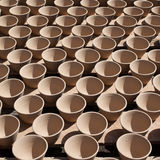 Para Rubber ceramic cup. Latex being collected from a wounded rubber tree Royalty Free Stock Images