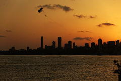 Para sailer against mumbai skyline Stock Images