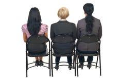 Para trás de três mulheres na apresentação Fotos de Stock Royalty Free