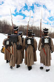 Para trás dos soldados na reconstrução histórica Imagem de Stock Royalty Free