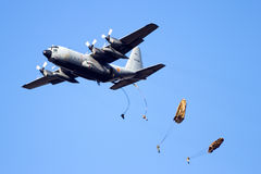 Para troopers. GINKELSE HEIDE, THE NETHERLANDS - SEP 22: A Belgian Air Force C-130 Hercules drops para troopers during the Operation Market Garden memorial on Stock Image