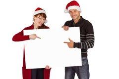 Para trzyma białego znaka Zdjęcia Royalty Free