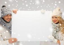 Para w zimy mienia pustego miejsca odzieżowej desce Fotografia Stock