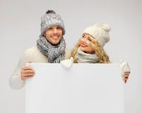 Para w zimy mienia pustego miejsca odzieżowej desce Fotografia Royalty Free