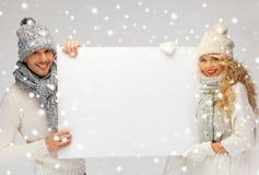 Para w zimy mienia pustego miejsca odzieżowej desce Obrazy Stock