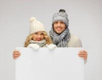 Para w zimy mienia pustego miejsca odzieżowej desce Zdjęcie Royalty Free