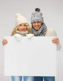 Para w zimy mienia pustego miejsca odzieżowej desce Obraz Stock