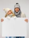 Para w zimy mienia pustego miejsca odzieżowej desce Zdjęcie Stock