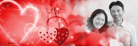 Para z valentine ` s miłości przemiany sercami Fotografia Stock