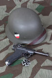 Parabellum handgun, helm and medal Iron Cross Stock Photography
