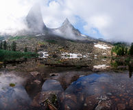 Parabola & reflection in painter's lake. Ergaki - fairytale real kingdom of pure nature - there are hundreds of rocks, mountain peaks, waterfalls and lakes Royalty Free Stock Image