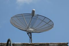 Parabolic Antenna. A parabolic antenna against a blue sky royalty free stock images