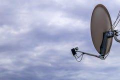 Parabolic antenna. A parabolic antenna against the sky Royalty Free Stock Photos