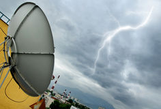 Parabolic antenna and lightning Stock Photo