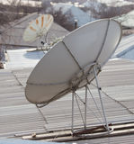 Parabolic antenna on the roof. Photo texture Stock Image